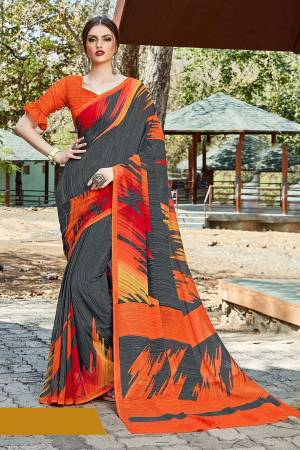 For Your Casual Or Semi-Casual Wear, Grab This Printed saree In Grey Color paired With Orange Colored blouse. This Saree And Blouse Are Fabricated On Georgette Beautified With Prints. It Is Light In Weight And Easy To Carry All Day Long.