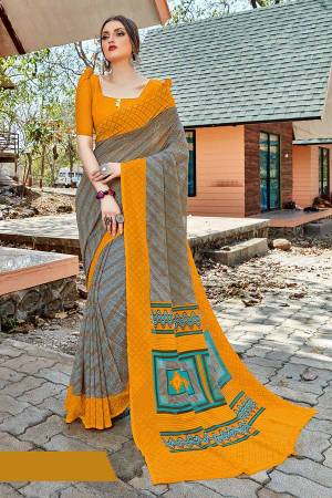 Simple And Elegant Looking Saree Is Here For Daily Wear In Grey color paired with Musturd Yellow Colored Blouse. This Saree And Blouse Are Georgette Based Which IS Light Weight And Ensures Superb Comfort All Day Long.