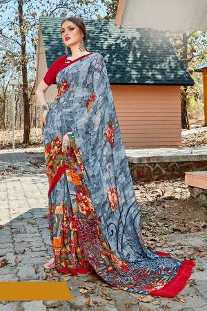 Simple And Elegant Looking Saree Is Here For Daily Wear In Grey color paired with Red Colored Blouse. This Saree And Blouse Are Georgette Based Which IS Light Weight And Ensures Superb Comfort All Day Long.
