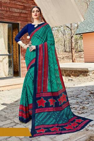 Simple And Elegant Looking Saree Is Here For Daily Wear In Sea Green color paired with Navy Blue Colored Blouse. This Saree And Blouse Are Georgette Based Which IS Light Weight And Ensures Superb Comfort All Day Long.
