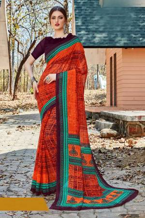 For Your Casual Or Semi-Casual Wear, Grab This Printed saree In Orange Color paired With Wine Colored blouse. This Saree And Blouse Are Fabricated On Georgette Beautified With Prints. It Is Light In Weight And Easy To Carry All Day Long.