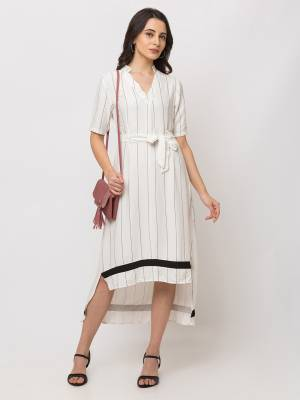 Here Is A Lovely High Low Patterned Readymade One-Piece Dress In White Color. This Dress Is Viscose Based Which Is Light Weight, Durable And Easy To Carry All Day Long.