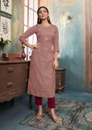 Grab This Designer Readymade Pair Of Kurti In Dusty Pink Color Paired With Maroon Colored Bottom. Its top Is Fabricated On Satin Silk Paired With Muslin Fabricated bottom. Both Its Fabrics Are Light Weight , Durable And Easy To Carry All Day Long.