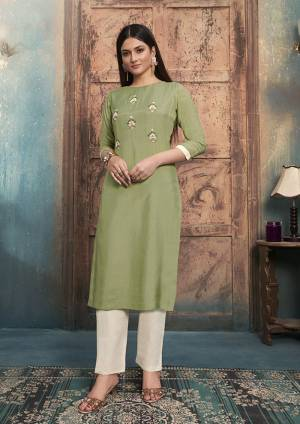 Grab This Designer Readymade Pair Of Kurti In Light Green Color Paired With Off-White Colored Bottom. Its top Is Fabricated On Muslin Paired With Mal Cotton Fabricated bottom. Both Its Fabrics Are Light Weight , Durable And Easy To Carry All Day Long.