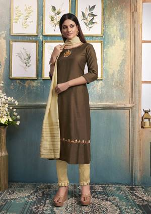 Be Ready For This Festive Season With This Readymade Straight Kurti In Brown Color Paired With Cream Colored Dupatta. This Kurti Is Satin Silk Based Paired With Viscose Silk Dupatta.