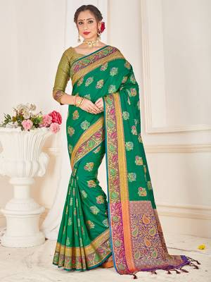 Here Is A Proper Traditional Looking Designer Silk Based saree In Green Color Paired With Green Colored Blouse. This Saree and Blouse AreFabricated On Banarasi Art Silk Beautified With Attractive Weave.