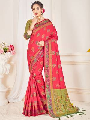 Here Is A Proper Traditional Looking Designer Silk Based saree In Rani Pink Color Paired With Green Colored Blouse. This Saree and Blouse AreFabricated On Banarasi Art Silk Beautified With Attractive Weave.