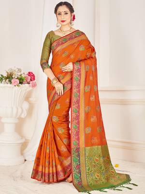 Here Is A Proper Traditional Looking Designer Silk Based saree In Rust Orange Color Paired With Green Colored Blouse. This Saree and Blouse AreFabricated On Banarasi Art Silk Beautified With Attractive Weave.