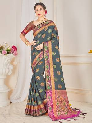 Here Is A Proper Traditional Looking Designer Silk Based saree In Dark Grey Color Paired With Magenta Pink Colored Blouse. This Saree and Blouse AreFabricated On Banarasi Art Silk Beautified With Attractive Weave.