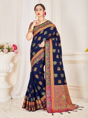 Here Is A Proper Traditional Looking Designer Silk Based saree In Navy Blue Color Paired With Magenta Pink Colored Blouse. This Saree and Blouse AreFabricated On Banarasi Art Silk Beautified With Attractive Weave.