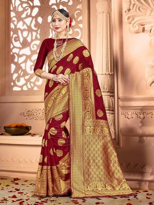 Shine Bright Wearing This Pretty Designer Maroon Colored Heavy?Weaved Saree. This Saree And Blouse Are Fabricated On Banarasi Art Silk Beautified With Weave All Over. It Is Suitable For Upcoming Wedding And Festive Season. Buy Now.