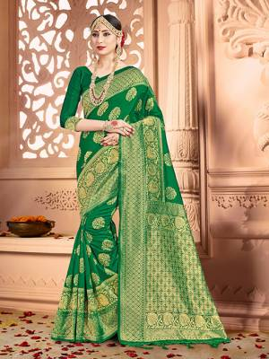 Shine Bright Wearing This Pretty Designer Green Colored Heavy?Weaved Saree. This Saree And Blouse Are Fabricated On Banarasi Art Silk Beautified With Weave All Over. It Is Suitable For Upcoming Wedding And Festive Season. Buy Now.