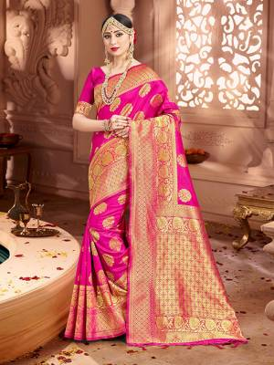 Shine Bright Wearing This Pretty Designer Rani Pink Colored Heavy?Weaved Saree. This Saree And Blouse Are Fabricated On Banarasi Art Silk Beautified With Weave All Over. It Is Suitable For Upcoming Wedding And Festive Season. Buy Now.