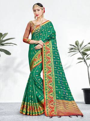 Shine Bright Wearing This Pretty Designer Teal Green Colored Heavy Weaved Saree. This Saree And Blouse Are Fabricated On Banarasi Art Silk Beautified With Weave All Over. It Is Suitable For Upcoming Wedding And Festive Season. Buy Now.