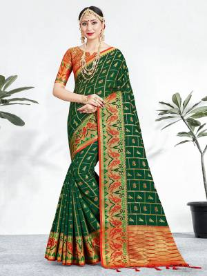 Shine Bright Wearing This Pretty Designer Dark Green Colored Heavy Weaved Saree. This Saree And Blouse Are Fabricated On Banarasi Art Silk Beautified With Weave All Over. It Is Suitable For Upcoming Wedding And Festive Season. Buy Now.