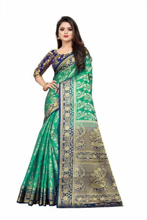 Celebrate This Festive Season In A Proper Traditonal Look Wearing This Silk Based Saree In Sea Green Color Paired With Royal Blue Colored Blouse. This Saree And Blouse Are Fabricated On Art Silk Beautified with Weave.