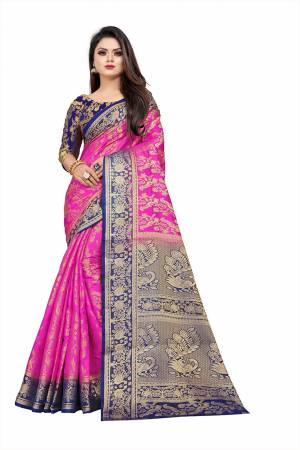 Grab This Beautiful Designer Weaved Saree In Rani Pink color Paired With Royal Blue Colored Blouse. This Saree And Blouse Are Fabricated On Art Silk Which Also Gives A Rich Look To Your Personality.