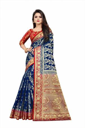 Celebrate This Festive Season In A Proper Traditonal Look Wearing This Silk Based Saree In Royal Blue Color Paired With Red Colored Blouse. This Saree And Blouse Are Fabricated On Art Silk Beautified with Weave.