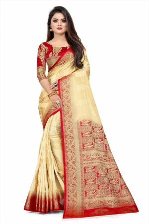 Grab This Beautiful Designer Weaved Saree In Cream color Paired With Red Colored Blouse. This Saree And Blouse Are Fabricated On Art Silk Which Also Gives A Rich Look To Your Personality.