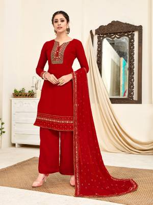 Here Is A Very Pretty Designer Straight Suit In All Over Red Color. Its Beautiful Embroidered Top And Dupatta Are Georgette Based Paired With Santoon Bottom. Buy This Pretty Suit Now.