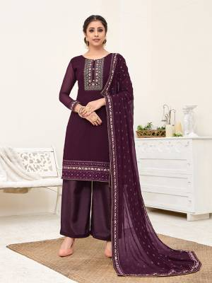 Here Is A Very Pretty Designer Straight Suit In All Over Purple Color. Its Beautiful Embroidered Top And Dupatta Are Georgette Based Paired With Santoon Bottom. Buy This Pretty Suit Now.