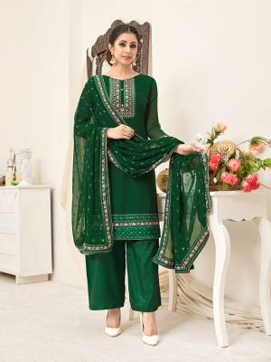 Here Is A Very Pretty Designer Straight Suit In All Over Dark Green Color. Its Beautiful Embroidered Top And Dupatta Are Georgette Based Paired With Santoon Bottom. Buy This Pretty Suit Now.