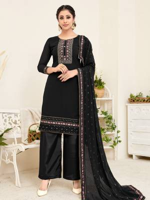 Here Is A Very Pretty Designer Straight Suit In All Over Black Color. Its Beautiful Embroidered Top And Dupatta Are Georgette Based Paired With Santoon Bottom. Buy This Pretty Suit Now.