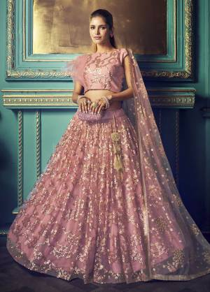 Get Ready For The Upcoming Wedding and Festive Season Wearing This Heavy Designer Lehenga Choli In Pink Color. Its Blouse And Lehenga Are Fabricated On Net Beautified With Heavy Attractive Embroidery.