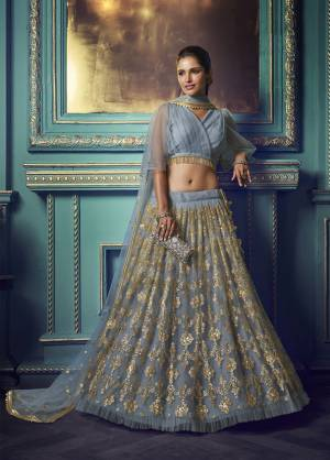 Here Is A Very Pretty Heavy Designer Lehenga Choli In Powder Blue Color. Its Pretty Heavy Embroidered Lehenga, Choli And Dupatta Are Fabricated On Net. Its Fabric, Color And Embroidery Will Earn You Lots Of Compliments From Onlookers.