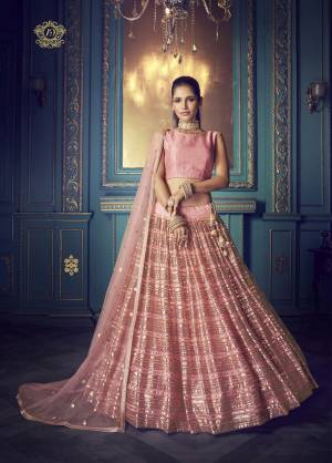 Here Is A Very Pretty Heavy Designer Lehenga Choli In Pink Color. Its Pretty Heavy Embroidered Lehenga, Choli And Dupatta Are Fabricated On Net. Its Fabric, Color And Embroidery Will Earn You Lots Of Compliments From Onlookers.