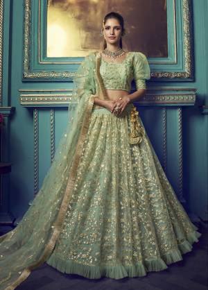 Get Ready For The Upcoming Wedding and Festive Season Wearing This Heavy Designer Lehenga Choli In Light Green Color. Its Blouse And Lehenga Are Fabricated On Net Beautified With Heavy Attractive Embroidery.
