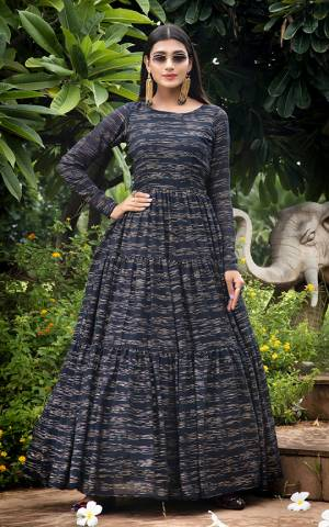 Grab This Designer Floor Length Gown In Navy Blue Color Fabricated On Georgette. This Pretty Gown Is Beautified With Prints, Also It Is Light In Weight And Easy To Carry All Day Long.