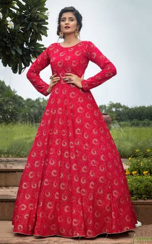 Celebrate This Festive Season Wearing This Designer Floor Length Gown In Dark Pink Color Fabricated On Georgette Beautified With Prints. Buy This Semi-Stitched Gown Now.