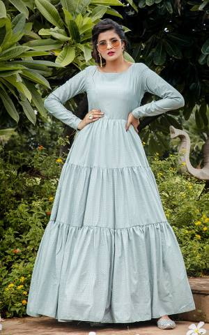 Celebrate This Festive Season Wearing This Designer Floor Length Gown In Pastel Blue Color Fabricated On Silk Blend Beautified With Prints. Buy This Semi-Stitched Gown Now.