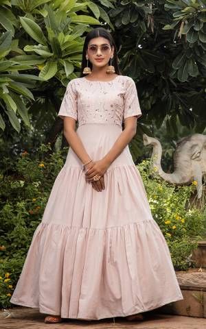 Grab This Designer Floor Length Gown In Pastel Pink Color Fabricated On Cotton. This Pretty Gown Is Beautified With Prints, Also It Is Light In Weight And Easy To Carry All Day Long.