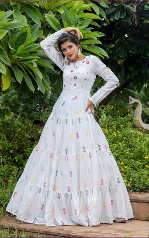 Celebrate This Festive Season Wearing This Designer Floor Length Gown In White Color Fabricated On Cotton Beautified With Prints. Buy This Semi-Stitched Gown Now.