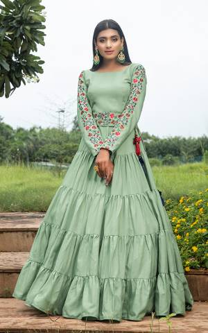 Grab This Designer Floor Length Gown In Light Green Color Fabricated On Cotton. This Pretty Gown Is Beautified With Prints, Also It Is Light In Weight And Easy To Carry All Day Long.