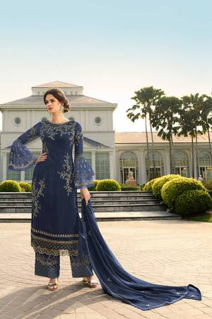 Look Beautiful Wearing This Heavy Designer Straight Suit In Navy Blue Color. This Pretty Embroidered Top And Dupatta Are Georgette Based Paired With Santoon Fabricated Embroidered Bottom. Buy This Designer Piece Now.