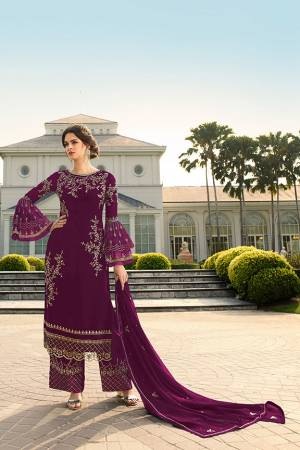 Look Beautiful Wearing This Heavy Designer Straight Suit In Wine Color. This Pretty Embroidered Top And Dupatta Are Georgette Based Paired With Santoon Fabricated Embroidered Bottom. Buy This Designer Piece Now.