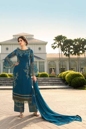 Look Beautiful Wearing This Heavy Designer Straight Suit In Blue Color. This Pretty Embroidered Top And Dupatta Are Georgette Based Paired With Santoon Fabricated Embroidered Bottom. Buy This Designer Piece Now.