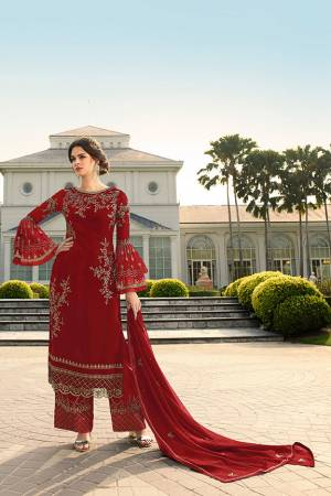 Look Beautiful Wearing This Heavy Designer Straight Suit In Red Color. This Pretty Embroidered Top And Dupatta Are Georgette Based Paired With Santoon Fabricated Embroidered Bottom. Buy This Designer Piece Now.