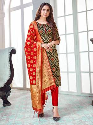 Here Is A Rich And Elegant Looking Silk Based Straight Suit In Black Colored Top Paired With Red Colored Bottom And Dupatta. Its Top And Dupatta Are Fabricated On Banarasi Silk Paired with Art Silk Bottom.