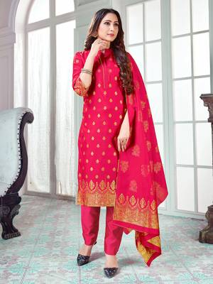 Here Is A Rich And Elegant Looking Silk Based Straight Suit In Rani Pink Color. Its Top And Dupatta Are Fabricated On Banarasi Silk Paired with Art Silk Bottom.