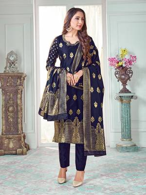 Celebrate This Festive Season In A Proper Traditional Look Wearing This Weaved Straight Suit In Navy Blue Color. This Pretty Suit Is Banarasi Silk Based Beautified With Weave. Its Fabric Gives A Rich Look To Your Personality