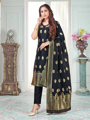 Here Is A Rich And Elegant Looking Silk Based Straight Suit In Black Color. Its Top And Dupatta Are Fabricated On Banarasi Silk Paired with Art Silk Bottom.