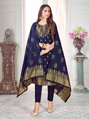 Here Is A Rich And Elegant Looking Silk Based Straight Suit In Navy Blue Color. Its Top And Dupatta Are Fabricated On Banarasi Silk Paired with Art Silk Bottom.