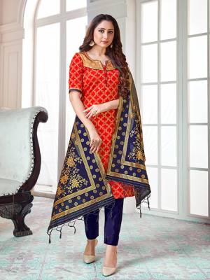 Here Is A Rich And Elegant Looking Silk Based Straight Suit In Red Colored Top Paired With Navy Blue Colored Bottom And Dupatta. Its Top And Dupatta Are Fabricated On Banarasi Silk Paired with Art Silk Bottom.