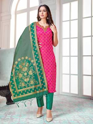 Celebrate This Festive Season In A Proper Traditional Look Wearing This Weaved Straight Suit In Rani Pink Colored Top Paired With Sea Green colored Bottom And Dupatta. This Pretty Suit Is Banarasi Silk Based Beautified With Weave. Its Fabric Gives A Rich Look To Your Personality