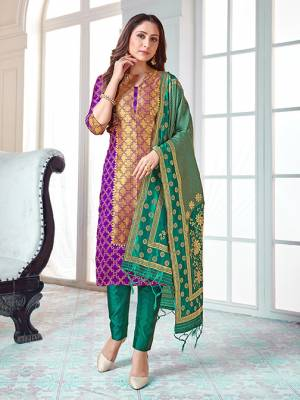 Here Is A Rich And Elegant Looking Silk Based Straight Suit In Purple Colored Top Paired With Sea Green Colored Bottom And Dupatta. Its Top And Dupatta Are Fabricated On Banarasi Silk Paired with Art Silk Bottom.