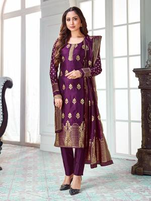 Here Is A Rich And Elegant Looking Silk Based Straight Suit In Purple Color. Its Top And Dupatta Are Fabricated On Banarasi Silk Paired with Art Silk Bottom.